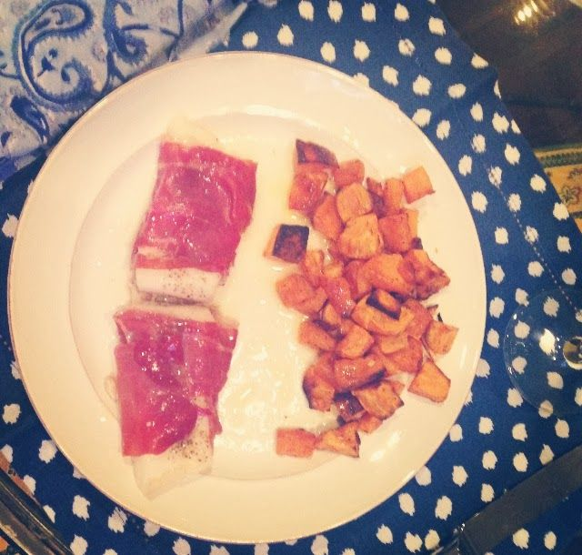prosciutto-wrapped halibut with roasted sweet potatoes.