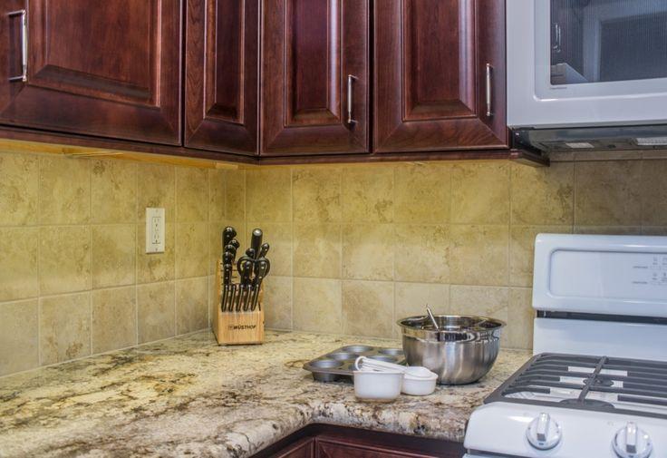 Seamless corner cut granite countertop design with this Poway ...