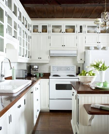 Butcher block kitchen counter tops and simple white tile backsplash.