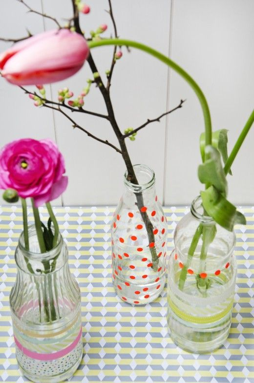 Glass bottle with stickers becomes a vase! Styling by Sjoesjoe and photo by Anniek Gelissen.