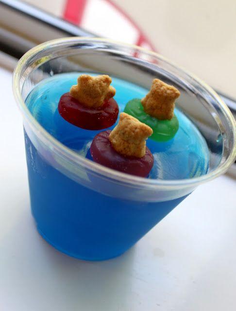 Teddy grahams in gummy lifesaver preservers in blue jello.