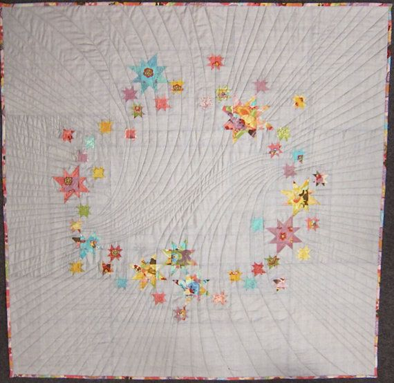 "Super stellar ""Rainbow Punch"" wonky star quilt by Mjdechenault."