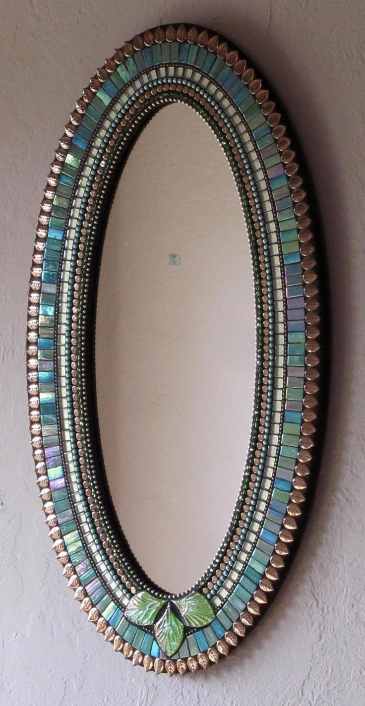 blue green and copper colored mosaic mirror