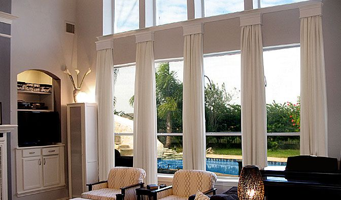 Window treatment idea two story room living room for 2 story window treatments