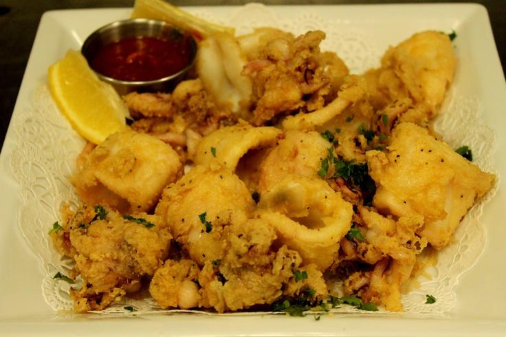 ... Dorati, golden fried calamari served with lemon and marinara sauce