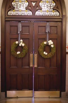 moss wreaths with garden roses on double doors
