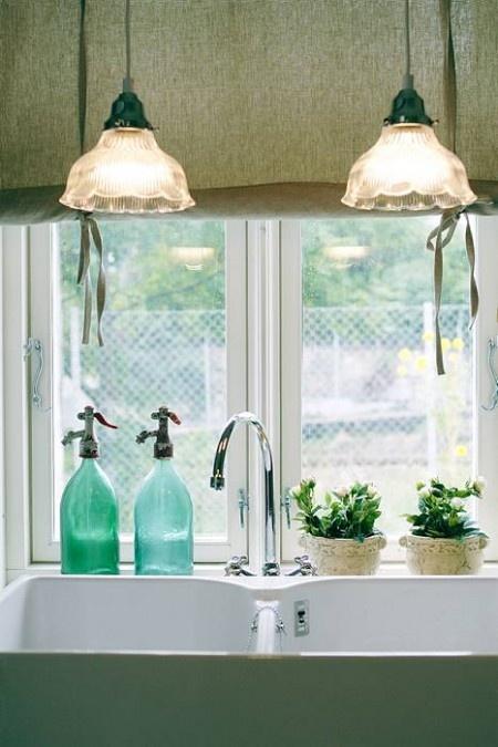 fresh herb in kitchen window in white pots