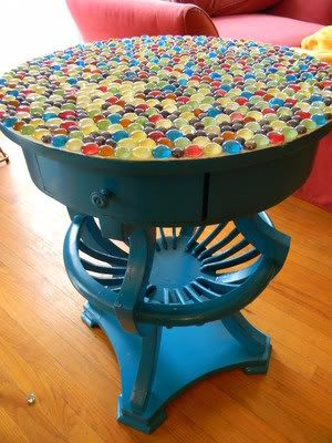 DIY: thrift store table, paint it, glue flat marbles on top, grout, buff & voila!