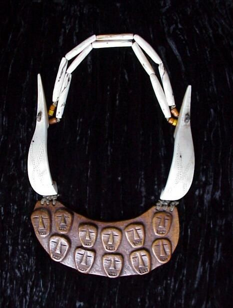 Naga, Breast Plate Necklace | Burmese Naga, Antique Bone Carved Pectoral, On Necklace Of Long Fine Etched Conch Shell Sections, With Shell Tube And Glass Beads | Pre 1920.