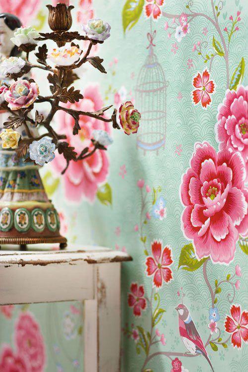 papel de pared de flores en colores turquesa y rosa