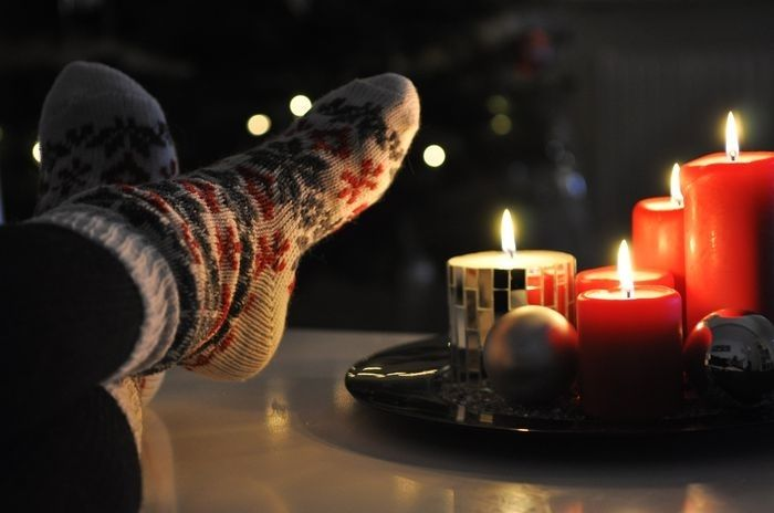 Warm and toasty bokeh night outdoors candles autumn feet socks