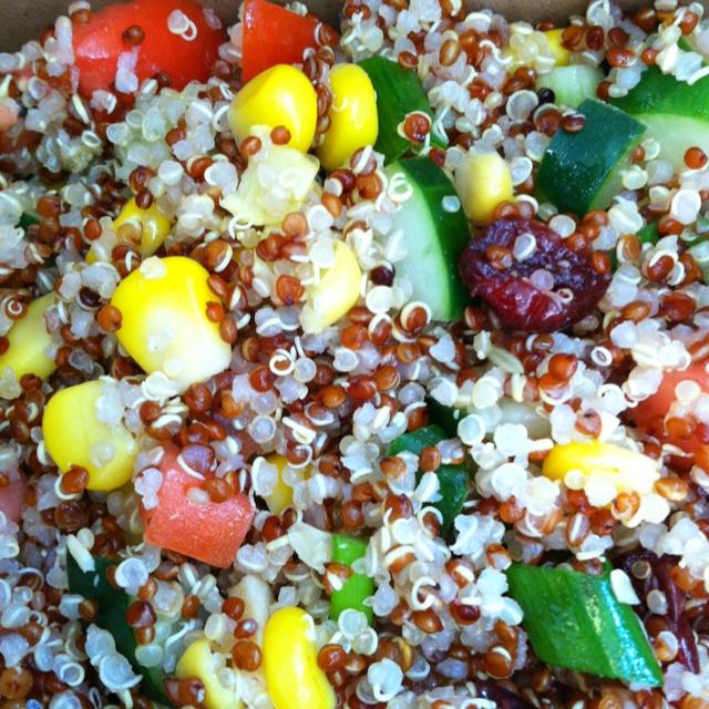 Quinoa salad with corn, cucumber, tomato, green scallions, cranberries ...