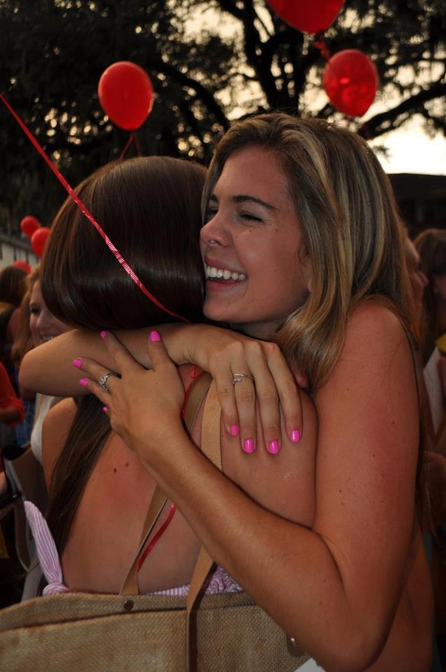 Chi Omega hugs on Bid Day