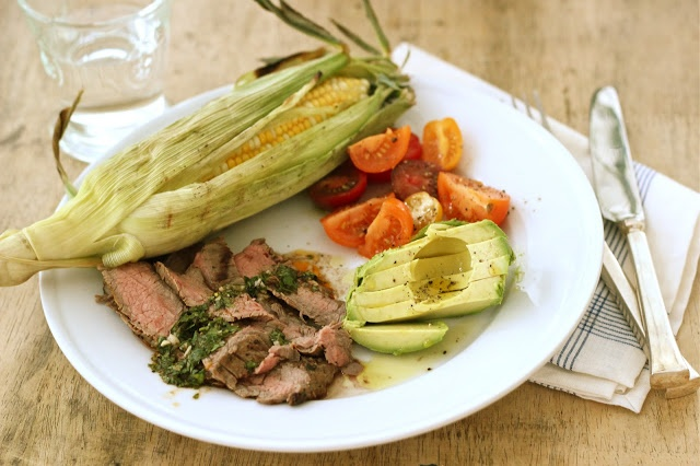 steak w/chimichurri sauce, grilled corn, sliced avocado, tomatoes ...