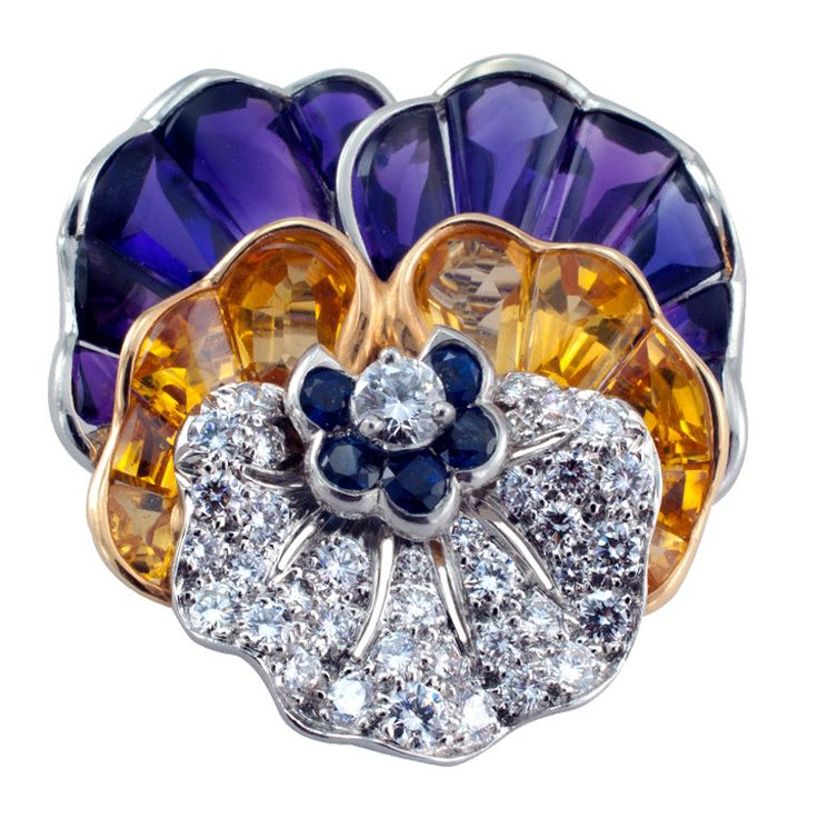 Tiffany & Co. This realistic sculptural designed pansy pin with jewel tones of amethyst and yellow sapphires are custom cut to fit, along with diamonds and blue sapphires. The diamonds total 1.28cts. Made in platinum and 18kt gold. Circa 1991s