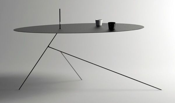 The minimal Chiuet table's über-thin surface is supported by an equally lanky 3-legged base that, from some angles, is so thin that you might wonder if it has disappeared altogether!