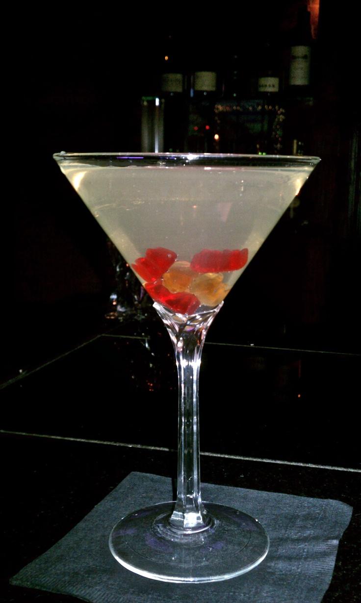 White Gummy Bear Martini: 1 ounce Raspberry Vodka, 1/2 ounce Peach Schnapps, 1/2 ounce sweet & sour mix, splash of Sprite, & 6 gummy bears!
