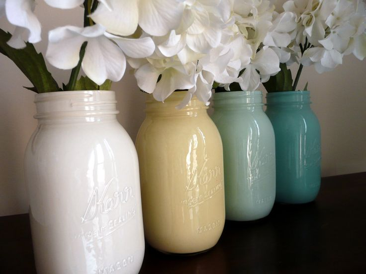 Painted Mason Jar Vases ~ Pour paint into a clean mason jar, rotate until inside is completely covered, pour out excess and let dry.