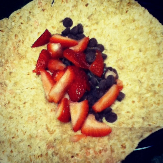 Whole wheat tortilla, dices strawberries, and sugar free dark ...
