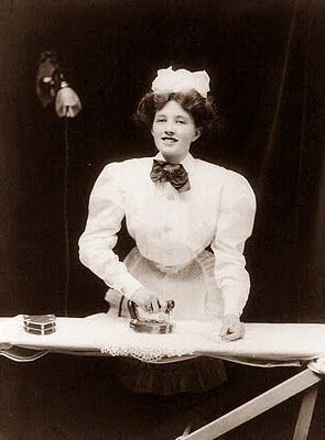 1908, woman ironing with a new GE electric iron....I'm guessing but would think she is a maid for a wealthy family or hotel employee. Certainly not the norm to have such a luxury in the family home.