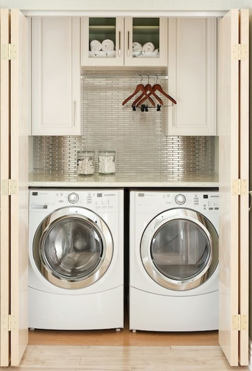 stainless steel backsplash in laundry room closet