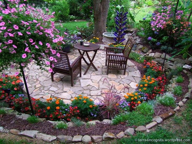 circular patio with surrounding flower beds