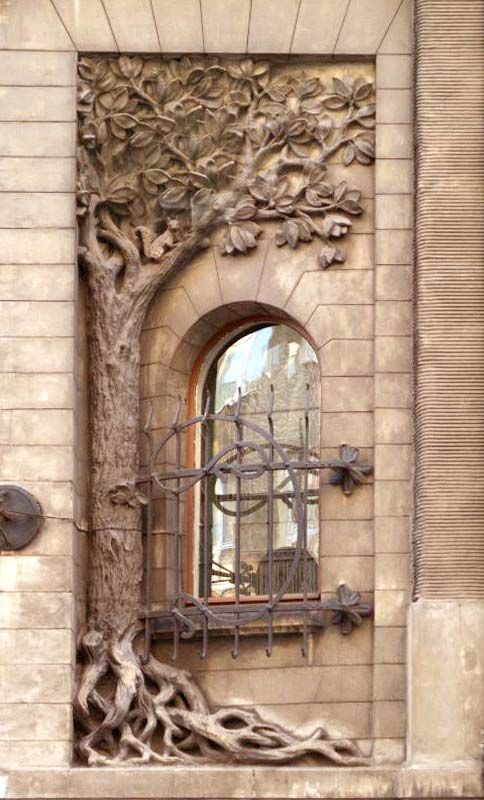 Handcrafted window design has a carved tree from roots to cute squirrel.  72b323bdb2c7574d368684b2c68d3e5a