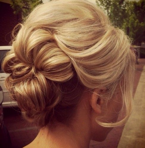 We love this beautiful 'do! 15 Glamorous Wedding Updos | Pretty Designs