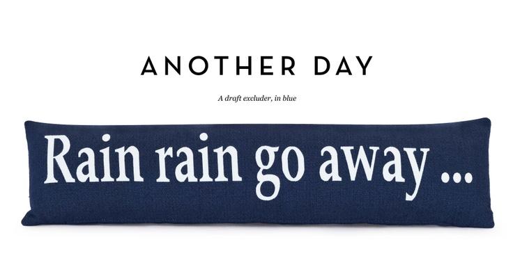 blue draft excluder... rain, rain go away...