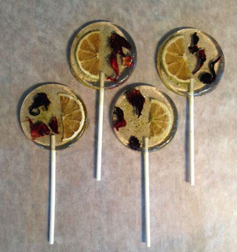 ... lime and hibiscus tea flavored lollipops with lime slices and hibiscus