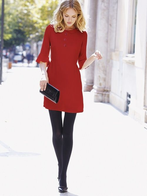 Red dress with black leggings and purse