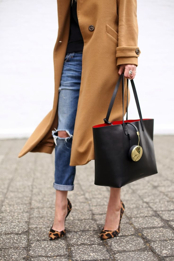 Something about a touch of leopard print that  glans up an outfit.  Love this long camel colored coat black top torn boyfriend jeans and pumps.  Throw in the black carry-all tote from