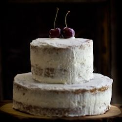 Brown sugar cake with fresh cherries and rose water whipped cream.