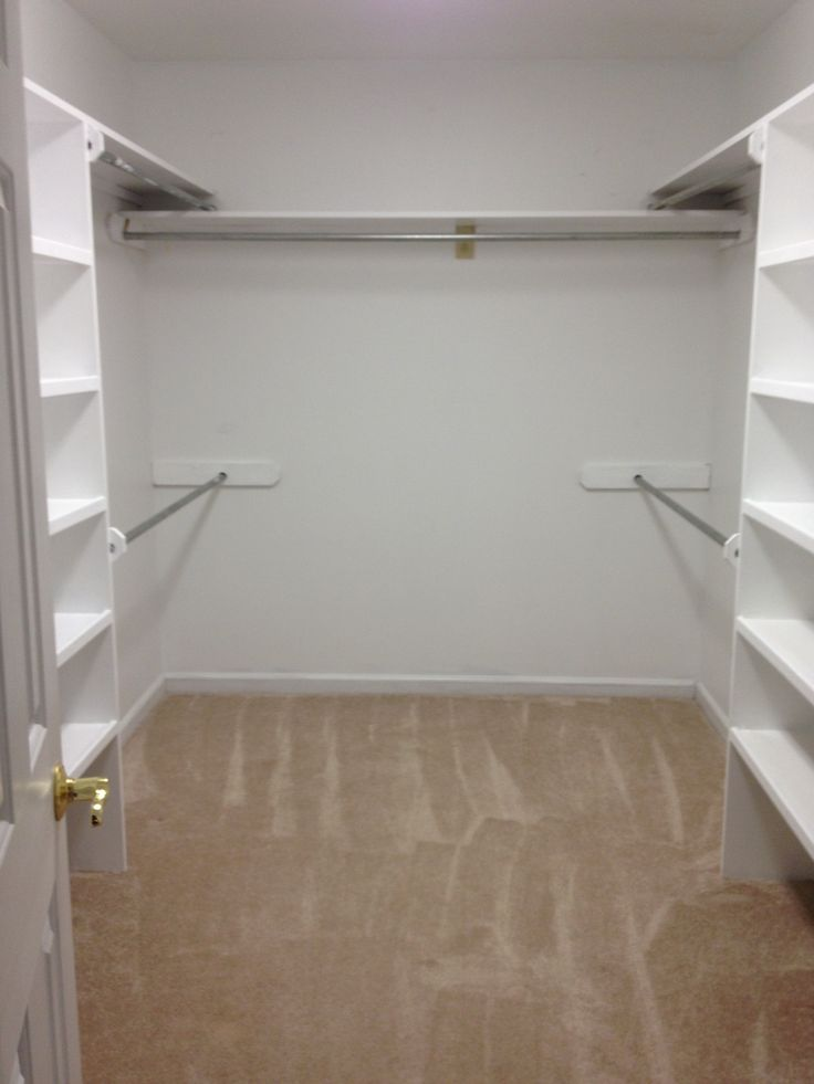 PERFECT CLOSET; each side has 4 rods w shelves in the middle, 1 long rod across back and shelves all around top