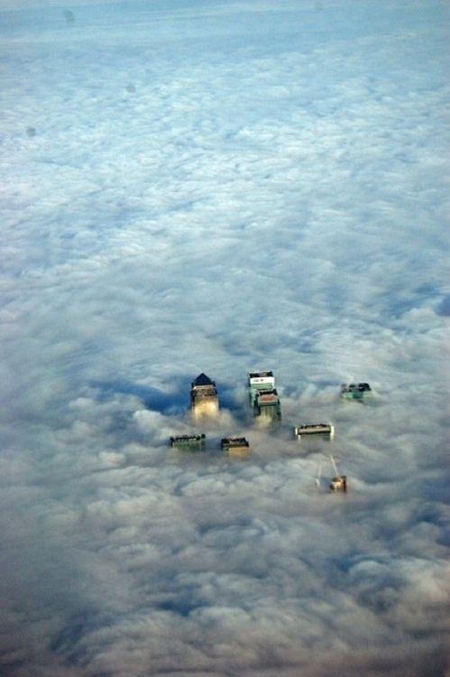 city of london peeking through the clouds.