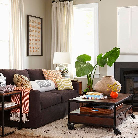 Q: I own a dark brown sofa. How can I keep the piece from dominating the look of the room? A: I love brown sofas. You can put any color of pillow on it. Keep the walls lighter, anchor the space with a light-color textural rug, and limit other dark browns to an accent chair or a picture frame. Bring in midtones such as hot pink, red, and teal.