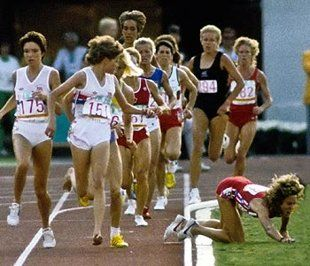 Zola Budd (wearing bib No. 151) looks back at Mary Decker, who's fallen into the infield.