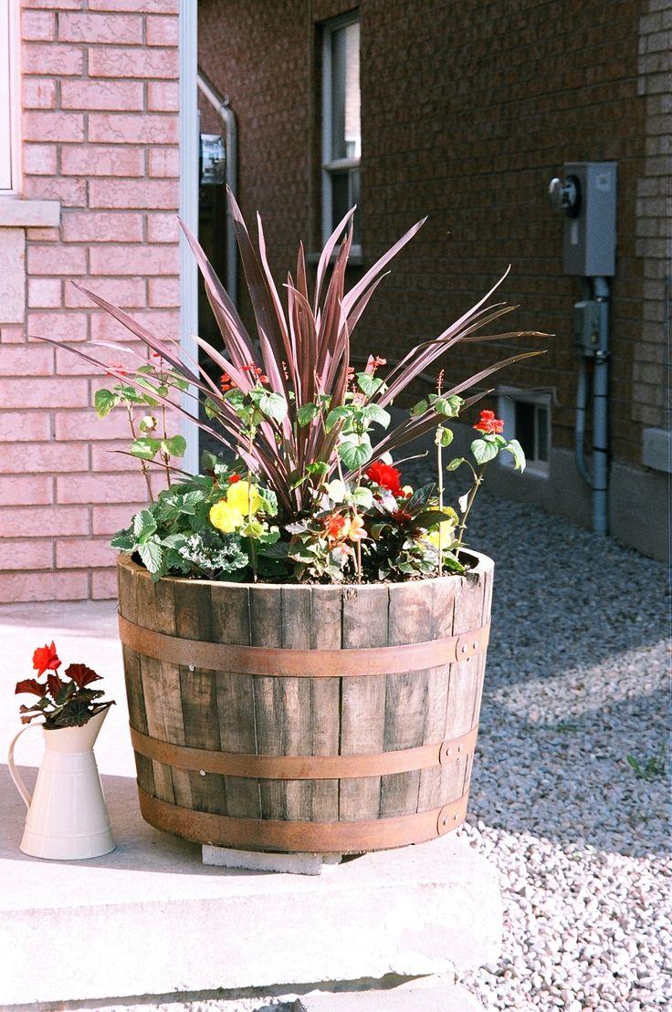 Whiskey barrel planter ideas car interior design for Wooden barrel planter ideas
