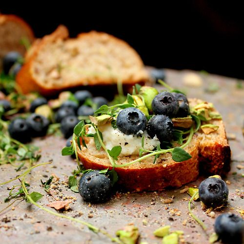 Fresh Blueberry, Thyme, & Roasted Pistachios, over Creamy Goat Cheese, & a Toasted French Baguette