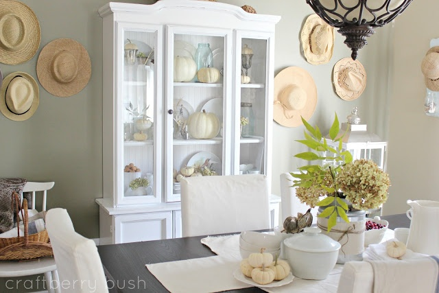 hutch: painted white, wood shelves, beadboard wallpaper backing, antique bronze hardware (and espresso dining table).