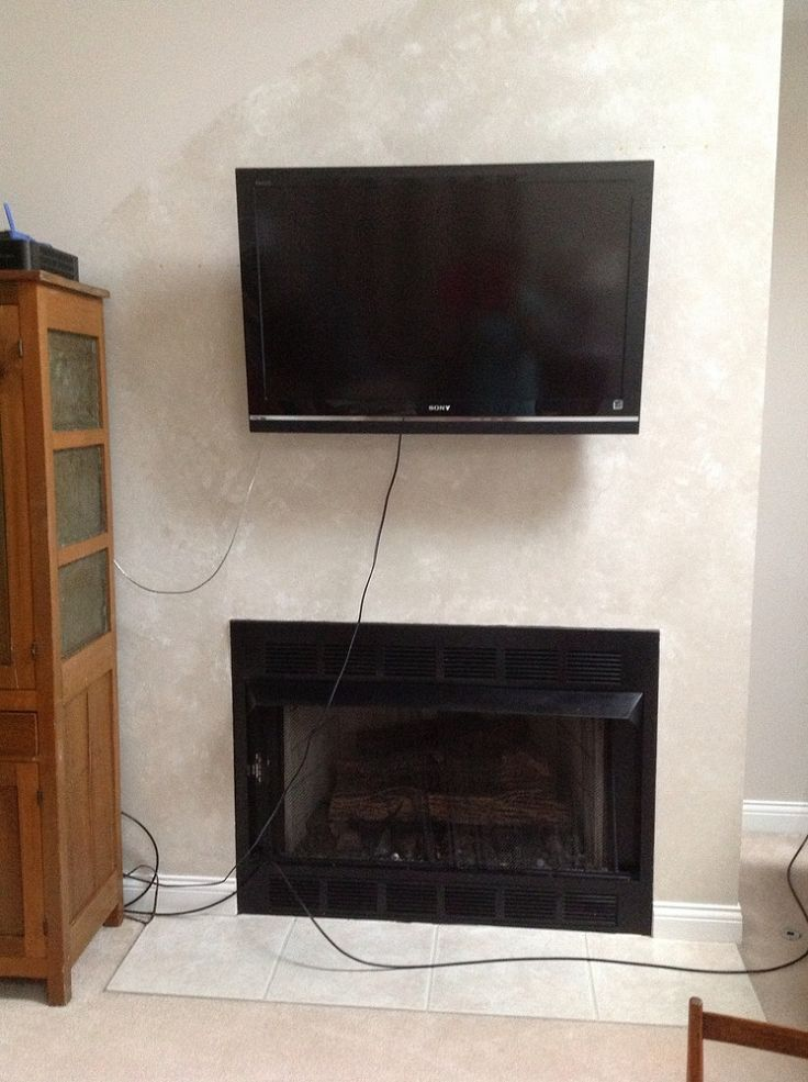 tv mounted above fireplace