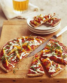 Whole-wheat pita bread forms the crust for these wedges of yellow pepper and mozzarella pizza with homemade tomato sauce. Fresh basil ribbons top each low-fat pizza wedge.
