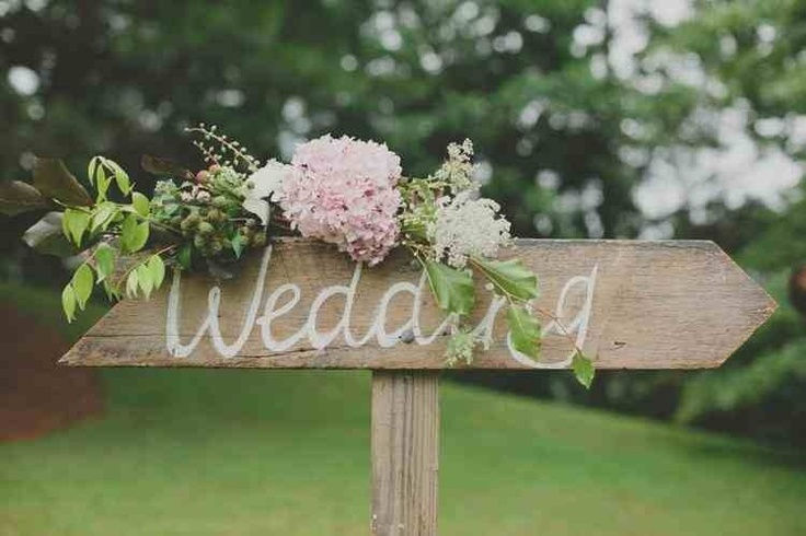 Wooden wedding sign and silk flower arrangement.