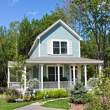 This is the front view of my dream house. I have always loved a light blue house with white trim, and a front porch like this one, but have never lived in such a house. As I head to retirement years, a huge house is too much for me. This size looks perfect!