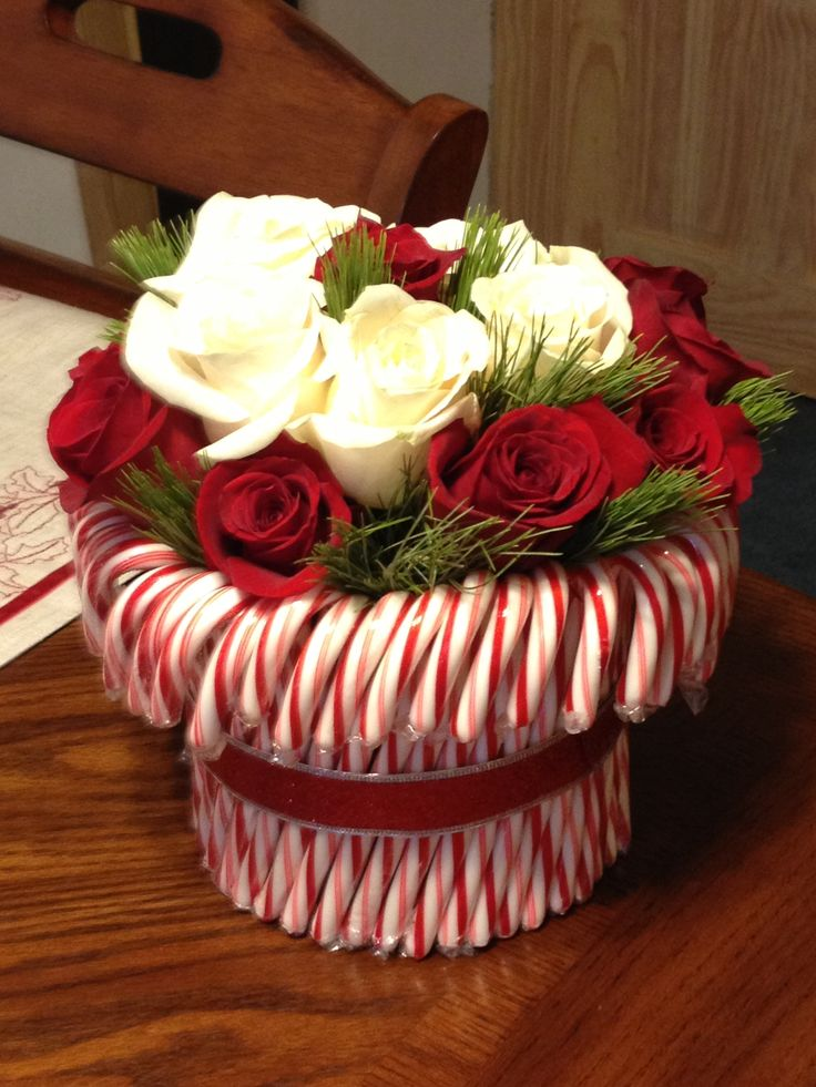 Candy cane rose centerpiece whimsical holiday party for Candy cane holder candle centerpiece