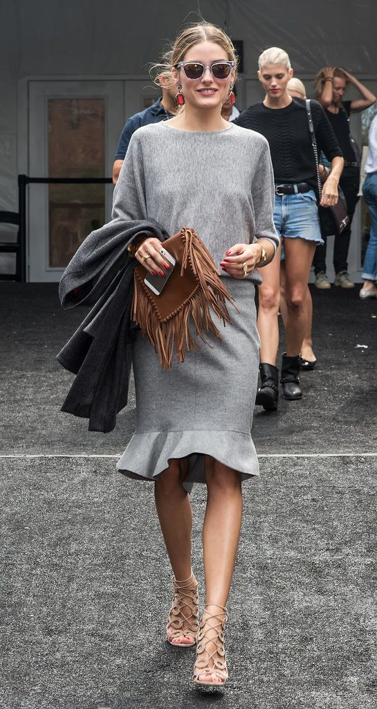 Best fashion front row @ Spring 2015 Ready-to-Wear #NYFW | Olivia Palermo in all grey outfit featuring a dolmen sweater and pencil skirt with ruffles at the hem, styled with a brown fringed pouch and nude Aquazzura + Olivia Palermo lace-up sandals