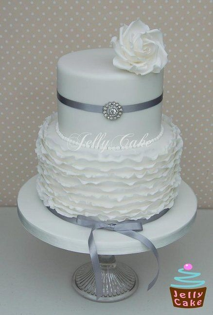 Frills Silver Wedding Cake, in stead of silver do grey ribbon and a blue flower on the top :) very elegant and cute!