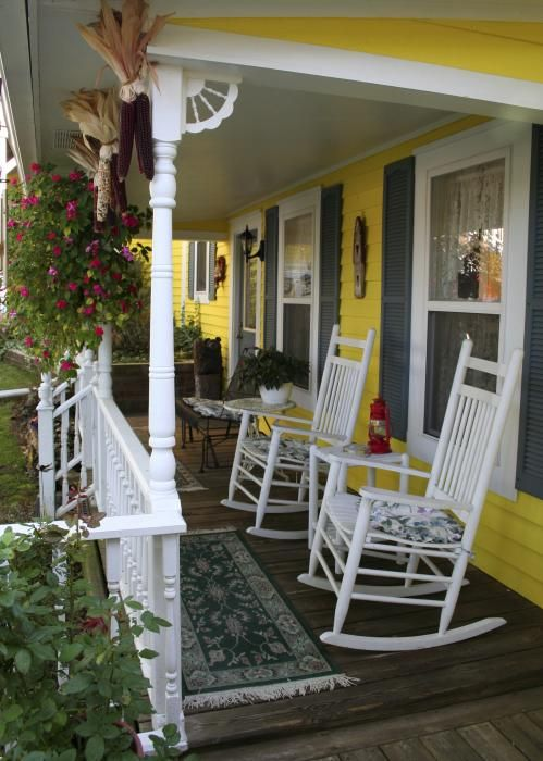 Rocking chair on a front porch .  The Porch  Pinterest