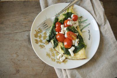 egg white omelet with spinach, basil, tomatoes, and goat cheese.