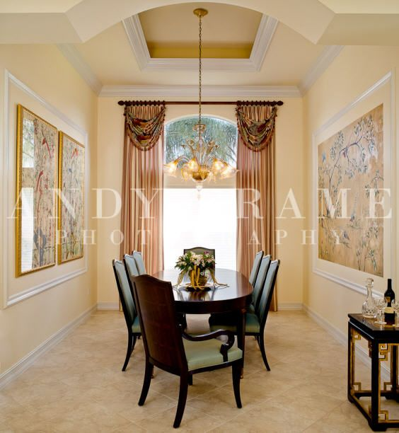 Formal dining room features complementary framed chinese silk panels